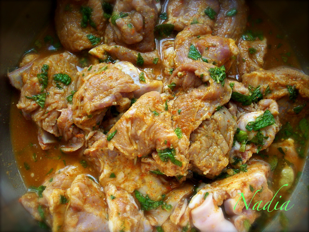 Marinate the meat in lemon juice, mint and spices (red chilli powder, ginger-garlic paste, cardamom, peppercorns, cloves, and green chillies) for an hour. Then cook with a little oil, till the water evaporates and meat is tender.