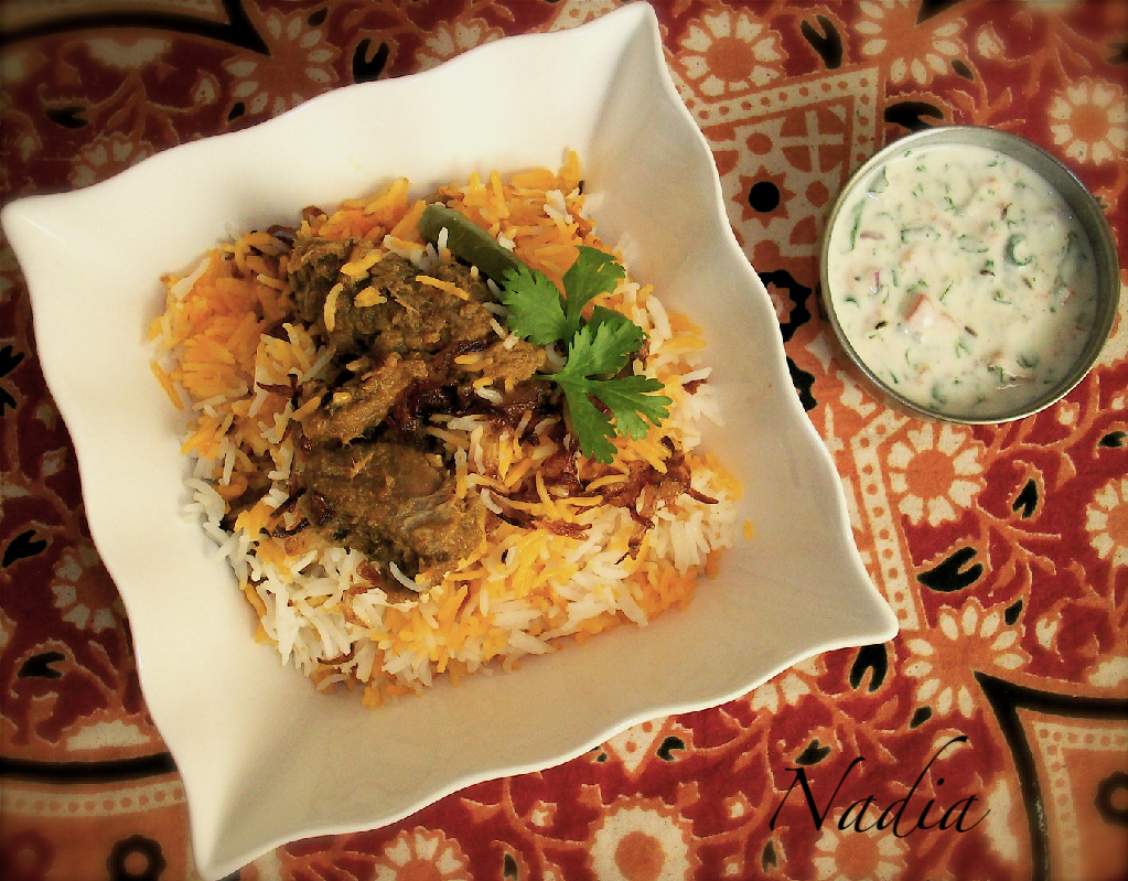 Serve with raita (whisked yoghurt with salt, black pepper, chopped onions and green chillies, coriander and mint leaves).